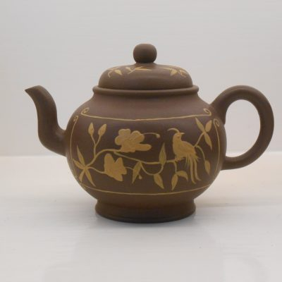 Round Yixing teapot with Clay decoration