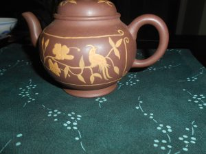 Round teapot with clay decoration