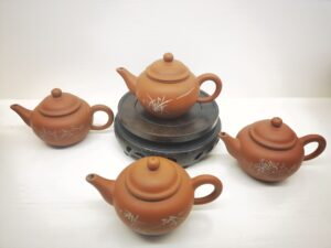Four red clay teapot set