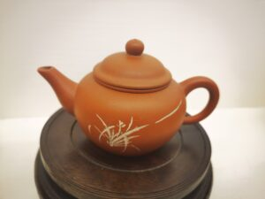 Four horizontal red clay teapot set