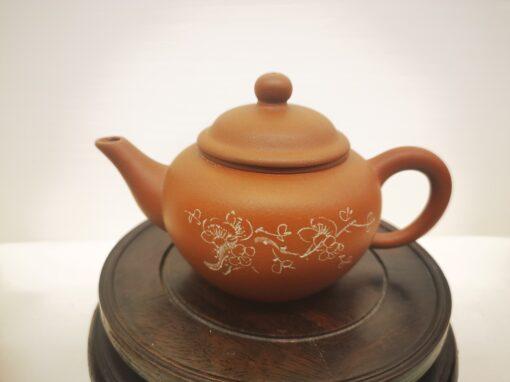 Four horizontal red clay teapot set